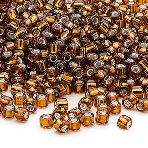 seed bead, dyna-mites™, glass, silver-lined translucent root beer, #6 round. sold per 40-gram pkg.
