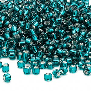 seed bead, dyna-mites™, glass, silver-lined translucent teal, #6 round. sold per 40-gram pkg.