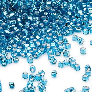 seed bead, dyna-mites™, glass, silver-lined translucent turquoise blue, #11 round with square hole. sold per 1/2 kilogram pkg.