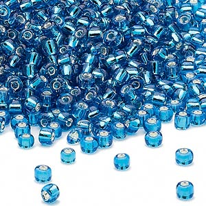 seed bead, dyna-mites™, glass, silver-lined translucent turquoise blue, #8 round. sold per 1/2 kilogram pkg.