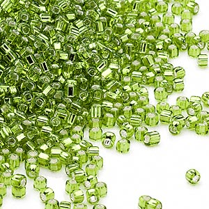 seed bead, dyna-mites™, glass, silver-lined transparent light green, #11 round with square hole. sold per 1/2 kilogram pkg.