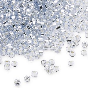 seed bead, dyna-mites™, glass, silver-lined transparent pale blue, #11 round with square hole. sold per 1/2 kilogram pkg.