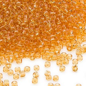 seed bead, dyna-mites™, glass, transparent amber yellow, #11 round. sold per 40-gram pkg.