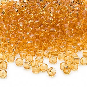 seed bead, dyna-mites™, glass, transparent amber yellow, #6 round. sold per 40-gram pkg.