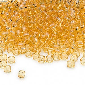 seed bead, dyna-mites™, glass, transparent light amber yellow, #6 round. sold per 1/2 kilogram pkg.