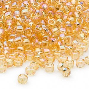 seed bead, dyna-mites™, glass, transparent rainbow amber yellow, #6 round. sold per 40-gram pkg.
