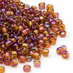 seed bead, dyna-mites™, glass, transparent rainbow root beer, #6 round. sold per 40-gram pkg.