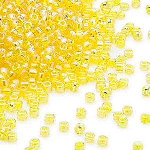 seed bead, dyna-mites™, glass, transparent rainbow yellow, #11 round. sold per 40-gram pkg.