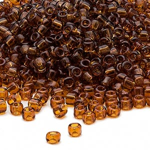 seed bead, dyna-mites™, glass, transparent root beer, #6 round. sold per 1/2 kilogram pkg.