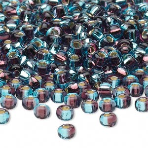 seed bead, glass, two-toned silver-lined aquamarine blue/plum, 3-4mm irregular round. sold per pkg of 250 grams.