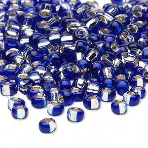 seed bead, glass, two-toned silver-lined cobalt blue/silver, 3-4mm irregular round. sold per pkg of 25 grams.