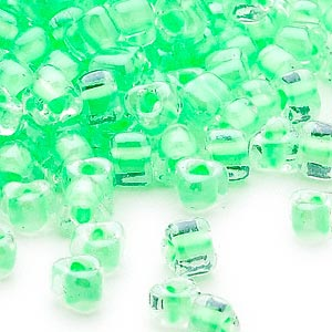 seed bead, miyuki, glass, transparent clear color-lined light green, (tr1120), #5 triangle. sold per 25-gram pkg.