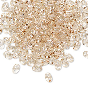 seed bead, preciosa twin™, czech glass, transparent crystal honey, 5x2.5mm oval with 2 holes. sold per 50-gram pkg.
