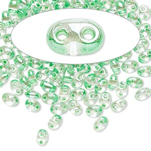 seed bead, preciosa twin™, czech glass, transparent light green-lined clear terra, 5x2.5mm oval with 2 holes. sold per 10-gram pkg.