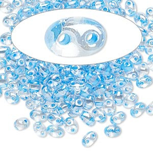 seed bead, preciosa twin™, czech glass, transparent sky blue-lined clear terra, 5x2.5mm oval with 2 holes. sold per 10-gram pkg.